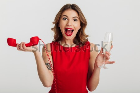 Laughing young woman closing eye with jewelery gift box Stock photo © deandrobot