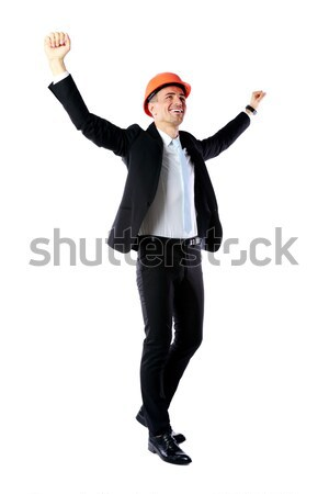 Full-length portrait of a cheerful businessman with hands raised over white background Stock photo © deandrobot