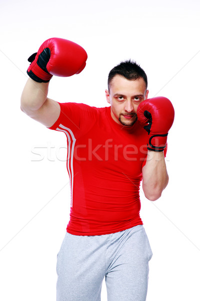 Fitness man punching with red boxing gloves isolated on white background Stock photo © deandrobot