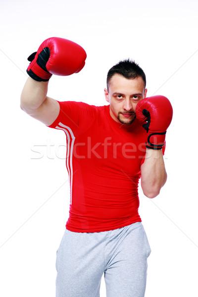 фитнес человека красный боксерские перчатки изолированный белый Сток-фото © deandrobot