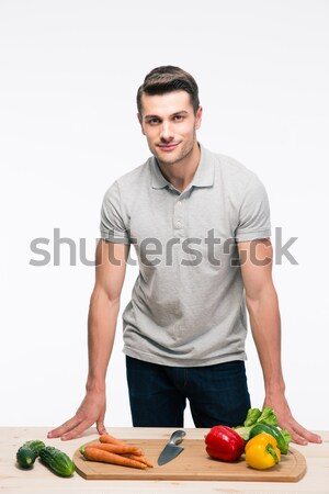 Man sitting on the table with vegetables Stock photo © deandrobot