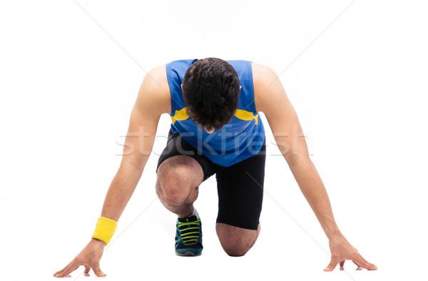 Man getting ready to run Stock photo © deandrobot