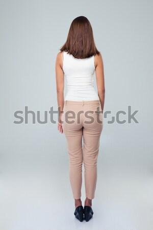 Vista posteriore ritratto casuale donna piedi grigio Foto d'archivio © deandrobot