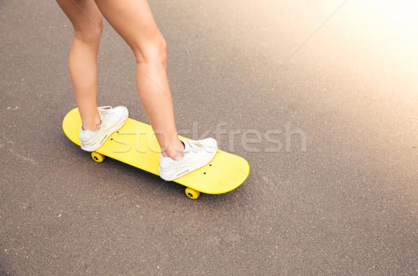 Női lábak gördeszka közelkép portré nő Stock fotó © deandrobot
