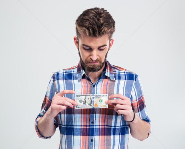 Man holding bill of USA dollar Stock photo © deandrobot