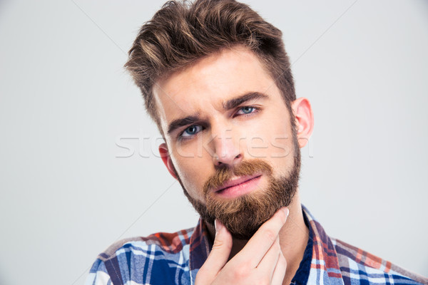 Férfi megérint szakáll töprengő fiatalember kéz Stock fotó © deandrobot