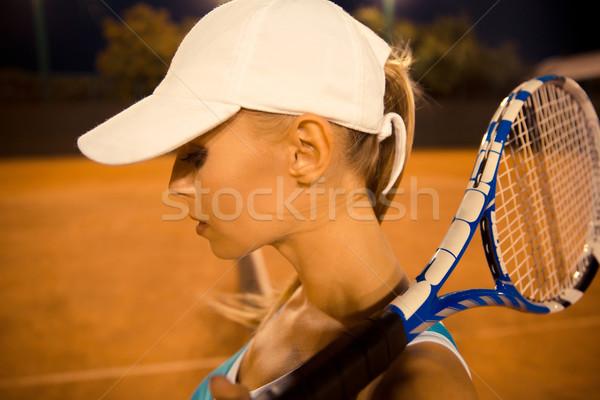 Női teniszező ütő portré sportok éjszaka Stock fotó © deandrobot