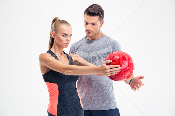 Woman workout with fitness ball  Stock photo © deandrobot