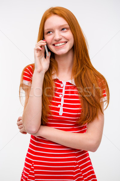 Boldog fiatal nő hosszú vörös haj beszél mobiltelefon Stock fotó © deandrobot