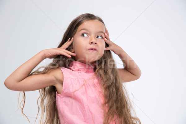 Little girl making silly face Stock photo © deandrobot