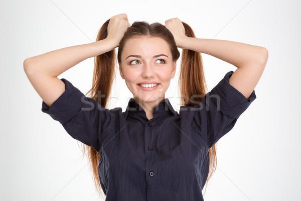 Szczęśliwy zabawny młoda kobieta dwa biały Zdjęcia stock © deandrobot
