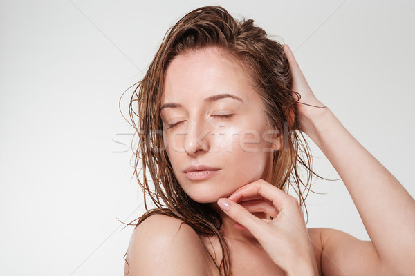 Relaxed woman with closed eyes Stock photo © deandrobot