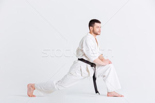 Férfi kimonó felfelé izolált fehér sportok Stock fotó © deandrobot