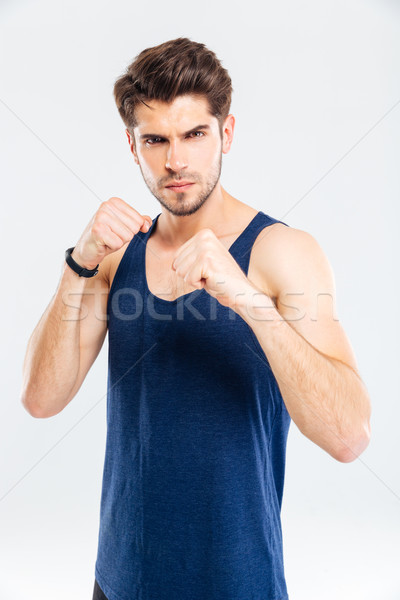 Portrait of a muscular male fighter standing Stock photo © deandrobot