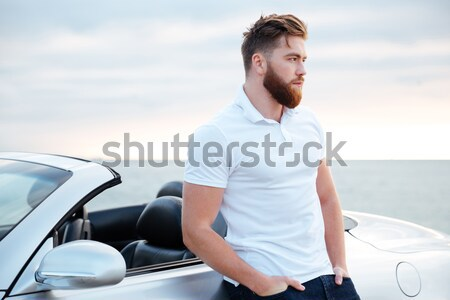 Cheerful man pilot standing near small plane Stock photo © deandrobot