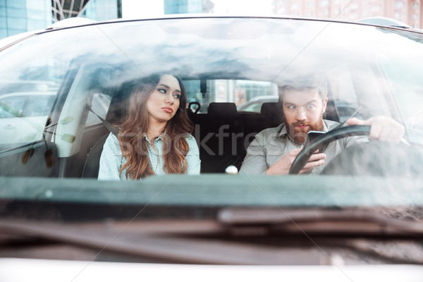 Funny couple in car Stock photo © deandrobot