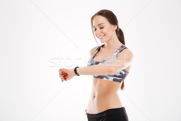 Fitness woman looking at watch Stock photo © deandrobot