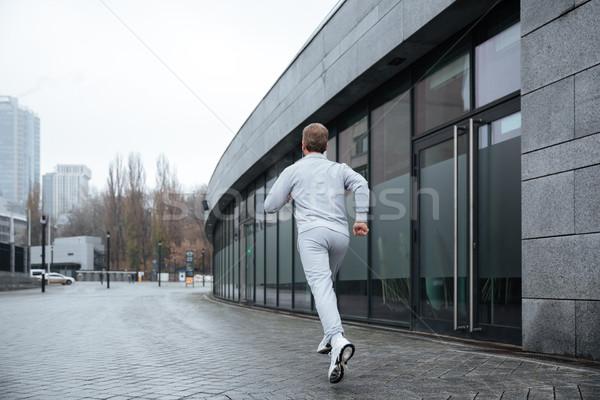 Full length man running on the street Stock photo © deandrobot