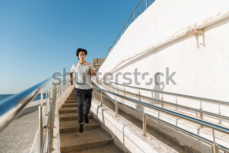 Stock photo: Happy elderly man on bridge