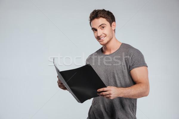 портрет счастливым удовлетворенный человека папке Сток-фото © deandrobot