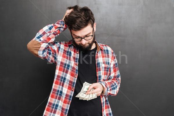 Confusi uomo piedi lavagna soldi Foto d'archivio © deandrobot