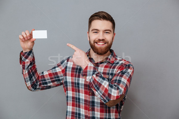 Handsome bearded man with copyspace business card Stock photo © deandrobot