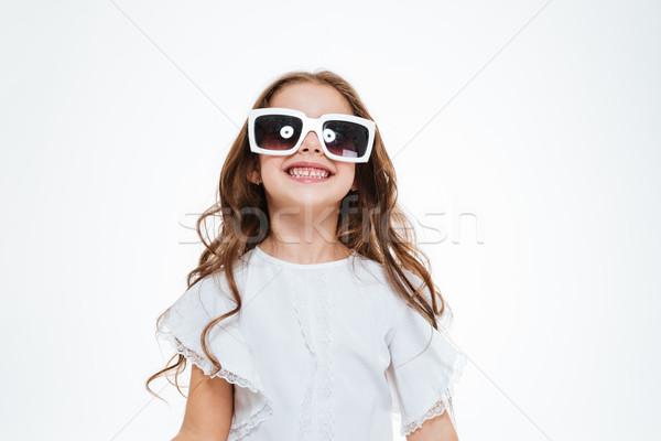 肖像 女の子 サングラス 立って 笑みを浮かべて ストックフォト © deandrobot