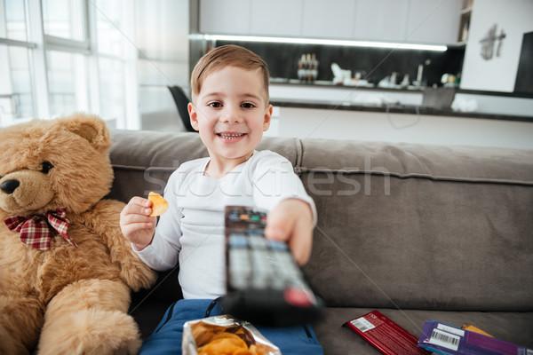 мальчика сидят диван мишка смотрят телевизор Сток-фото © deandrobot