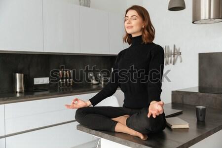 Amazing woman make yoga exercises. Stock photo © deandrobot