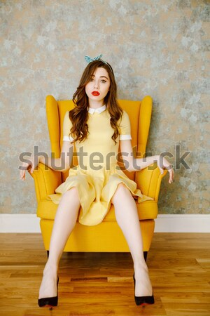 Stock photo: Pretty young pin up girl in yellow dress