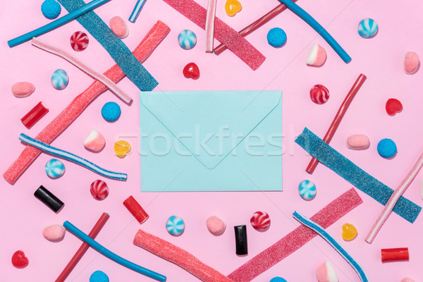 Sweet jelly licorice candy sticks and lollies with blank paper Stock photo © deandrobot