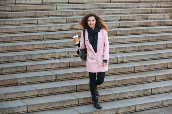 Tam uzunlukta portre kadın yürüyüş merdiven kat Stok fotoğraf © deandrobot