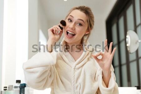 Heureux femme poudre brosse maquillage Photo stock © deandrobot