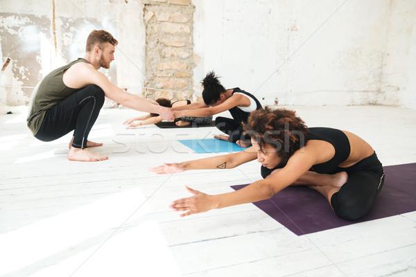 Mężczyzna jogi instruktor pomoc kobieta człowiek Zdjęcia stock © deandrobot