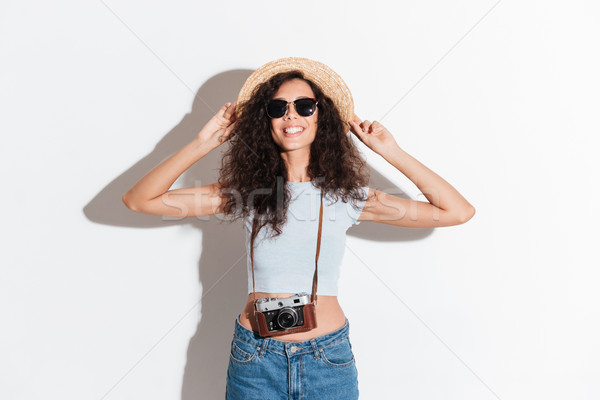 Young woman with retro camera smiling to camera Stock photo © deandrobot