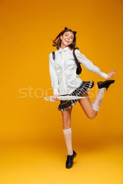 Retrato alegre jóvenes colegiala uniforme Foto stock © deandrobot