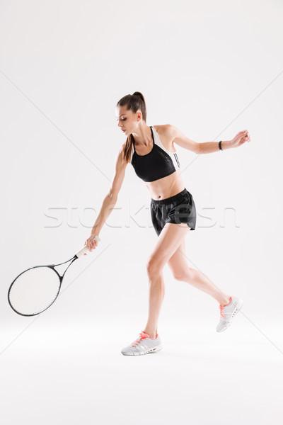 Teljes alakos portré gyönyörű nő teniszező ütő izolált Stock fotó © deandrobot