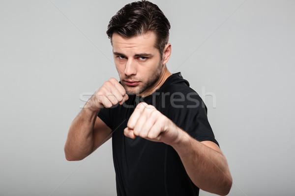 Close up portrait of a strong fit sportsman Stock photo © deandrobot