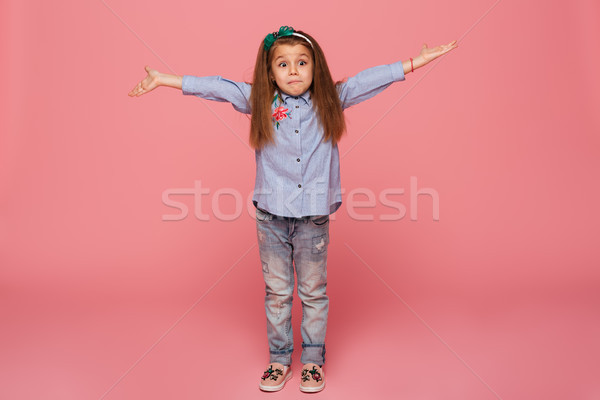 Lovely child girl in hair hoop and casual clothes giving huge hu Stock photo © deandrobot