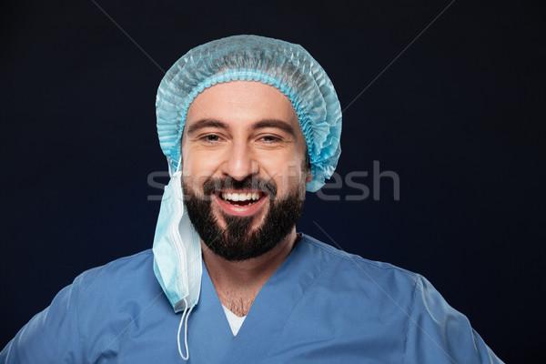 Portrait souriant Homme chirurgien barbu Photo stock © deandrobot