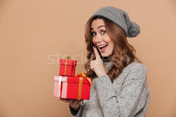молодые улыбаясь брюнетка женщину молчание Сток-фото © deandrobot