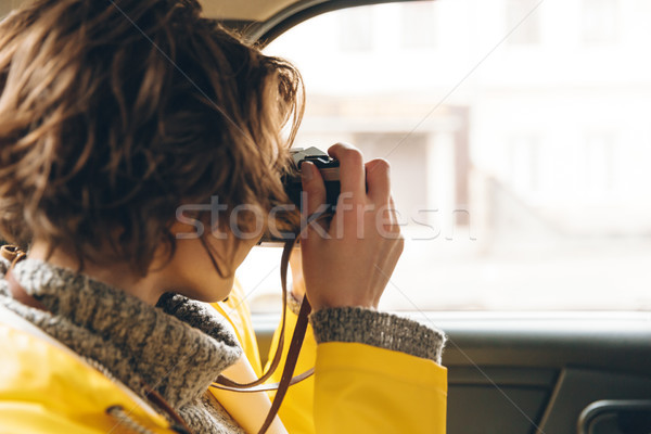 Pretty young lady photographer dressed in raincoat Stock photo © deandrobot