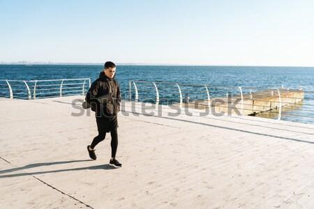 Portret zdrowych sportowiec jogging plaży niebo Zdjęcia stock © deandrobot
