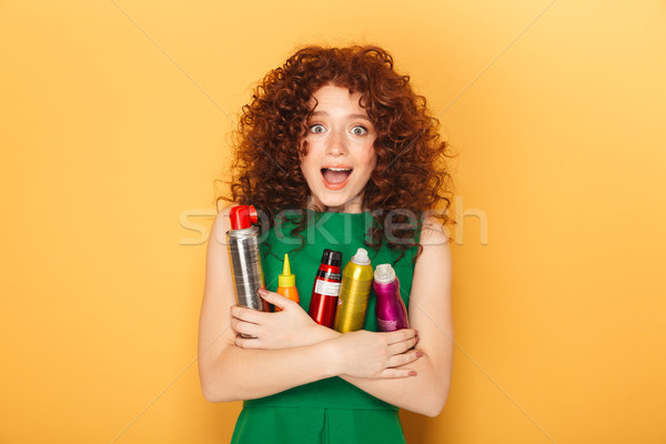 Portrait of a satisfied curly redhead woman Stock photo © deandrobot