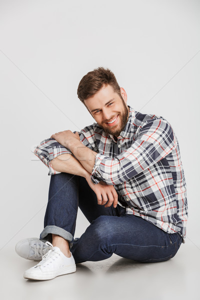 Portrait of a happy young man in plaid shirt Stock photo © deandrobot