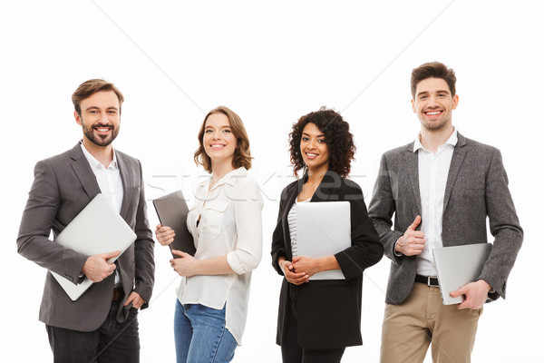 Portrait of a group of confident multiracial business people Stock photo © deandrobot