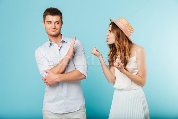 Angry caucasian loving couple friends quarrel. Stock photo © deandrobot