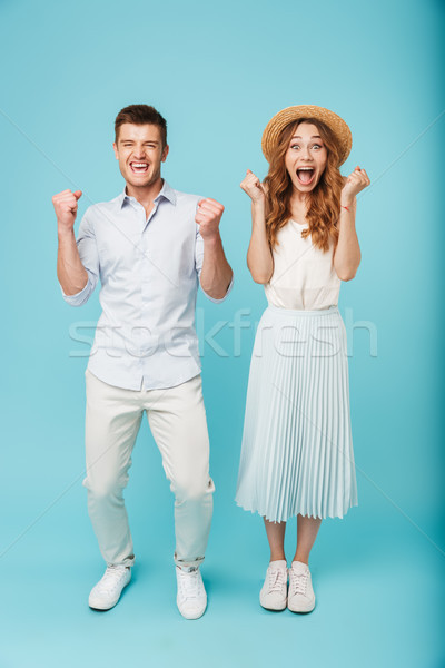 Excited caucasian people man and woman make winner gesture screaming. Stock photo © deandrobot