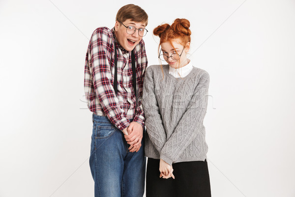 Shy couple of school nerds looking at camera Stock photo © deandrobot