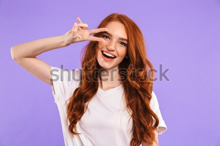 Stock photo: Portrait of a positive young girl holding mobile phone
